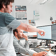 Two FRS employees in a headquarter office.